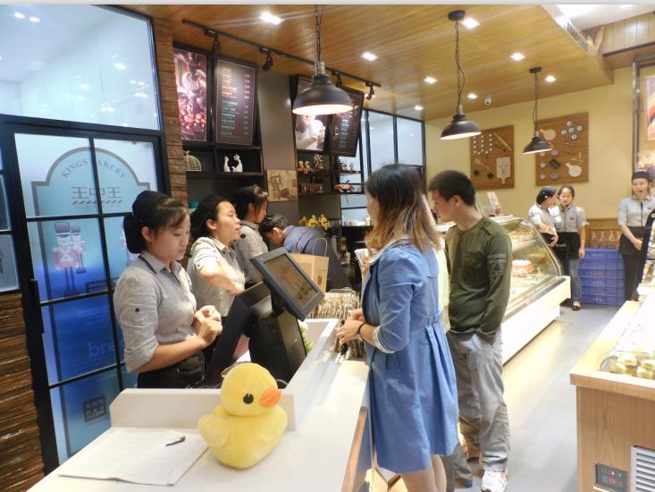 ,这也是鄱阳王中王蛋糕店自成立至今发展起来的第五家店.高清图片