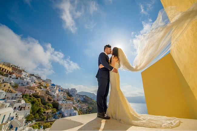 圣托里尼的碧海旅行婚�照 �S心浪漫出�l